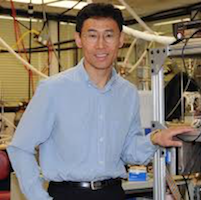 Dr. Zhang standing in a lab